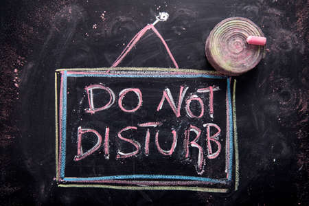 quiet room: Graphic representation of the word, do not disturb, written with chalk on blackboard Stock Photo