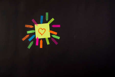post it notes: Post it colored with a drawn heart symbol of love Stock Photo