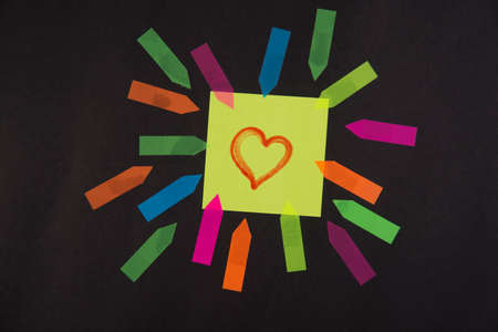 post it: Post it colored with a drawn heart symbol of love Stock Photo