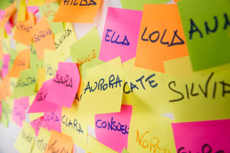 my name is: Womens names written on post it in different colors