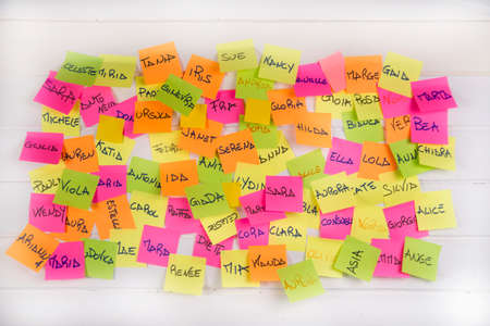 Women's names written on post it in different colors