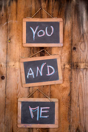 infatuation: Graphic representation of the word, you and me, written with chalk on blackboard