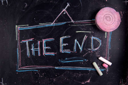 conclude: Graphical representation of the word, The End, written with chalk on blackboard