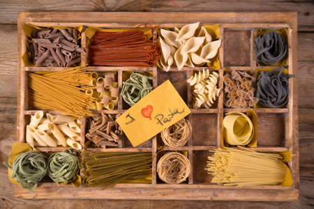 varieties: Presentation in wooden varieties of pasta made in Italy