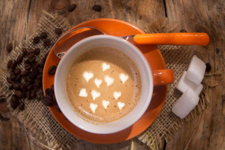 morning coffee: Cup of hot coffee represented with drawings of love hearts Stock Photo