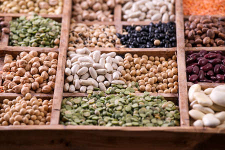 pulses: Presentation of mixed seeds of pulses in a display of wood Stock Photo