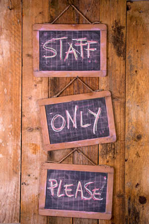 private access: Signposts space reserved to authorized personnel only written with chalk on blackboard Stock Photo