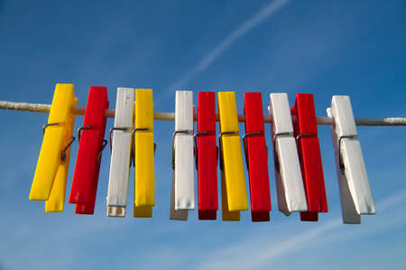 plastic material: Tweezers for cloths made of plastic material of various colors ready on wire Stock Photo