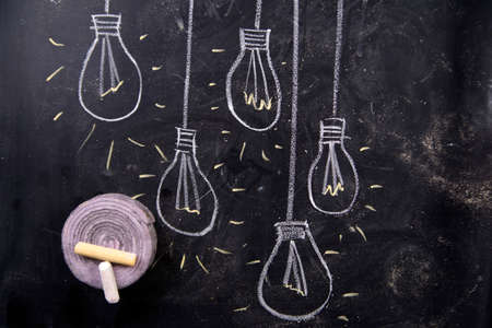 watts: Drawing with chalk on the blackboard of some bulbs Stock Photo