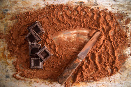 cocoa powder: Cocoa powder and dark chocolate on the table Stock Photo