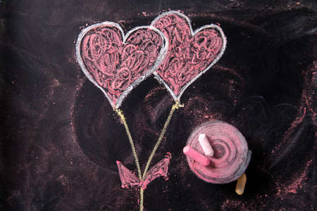 Done graphical representation with chalk on blackboard symbol of love, the heart Reklamní fotografie