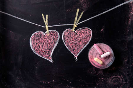 beat women: Done graphical representation with chalk on blackboard symbol of love, the heart