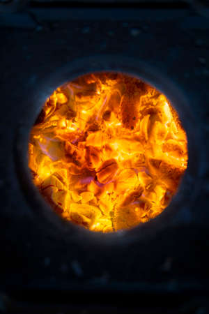 wood burning stove: Embers from the burning of wood in a stove Stock Photo
