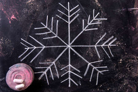 Graphic representation with chalk on blackboard symbol of snow Stock Photo