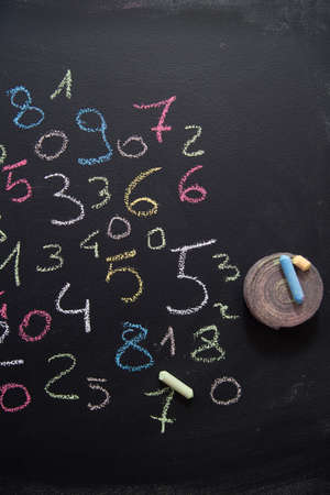 arabic numeral: Graphic representation with chalk on blackboard with colorful numbers Stock Photo