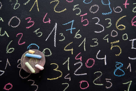 Graphic representation with chalk on blackboard with colorful numbers Standard-Bild