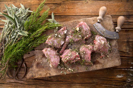 meat diet: Preparation with chopped aromatic Mediterranean herbs of raw rabbit portions