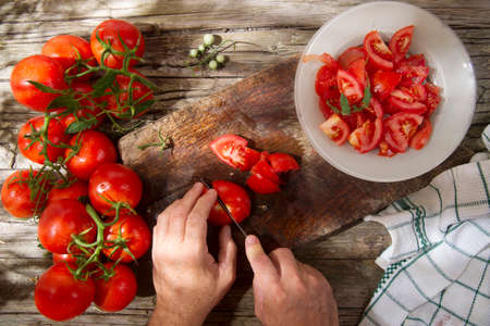 preserves: Cut and prepare preserves for the winter with smooth round tomato