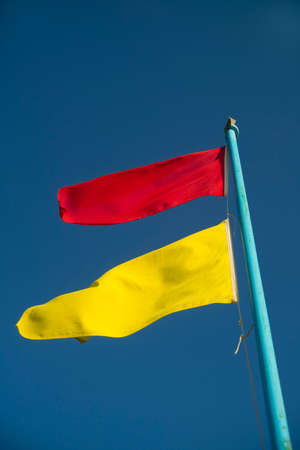 unattended: Yellow and red flags of danger without the supervised beach