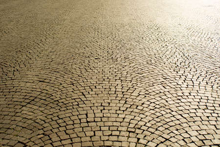 cobblestones: Urban square paved with cobblestones of the old system