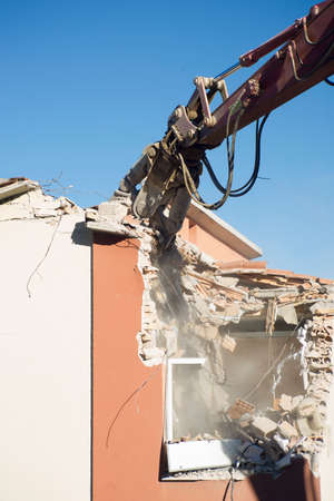 The controlled demolition of a home made uninhabitable by the earthquake in central Italia