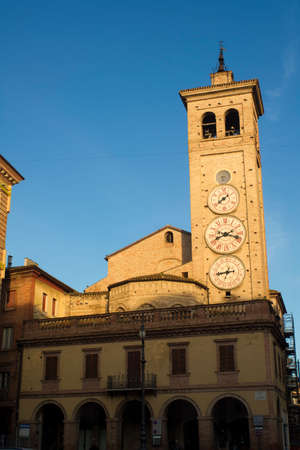 three months old: The church of San Francesco with the tower clocks in Tolentino Italy Stock Photo
