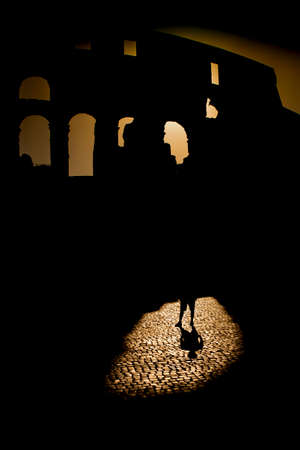 Street photography represents the shadows that arise at sunset time