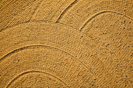 Photography with the use of the drone of the drawings left on a plowed field Stock Photo