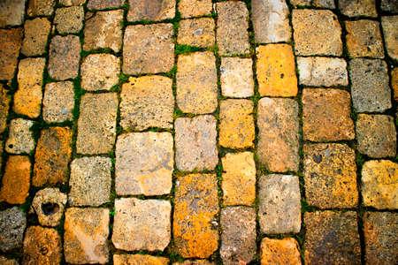 Podium photographic representation of an old stone pavement