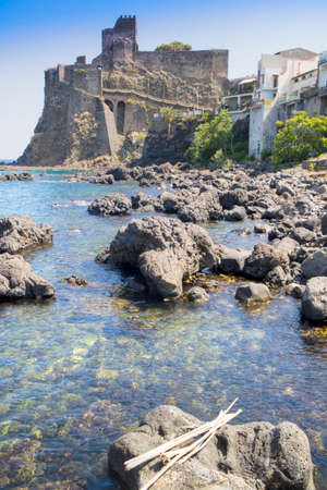 View of the ancient and historic Castle on the coast of Aci Castello in Sicily Italy 新聞圖片