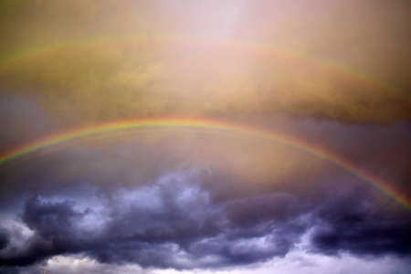 View of the sky after the storm with the presence of the rainbow