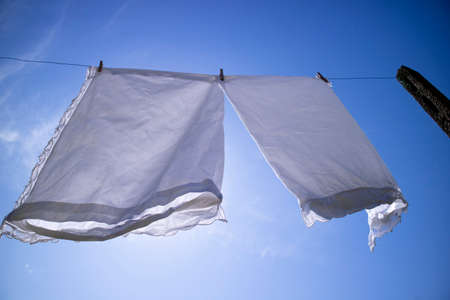 Photographic shot of some clothes of the house lying in the sun to dry Standard-Bild