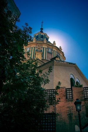 spanish  architecture: the sun sinks behind the tower of the Monasteria de Santa Paula Stock Photo