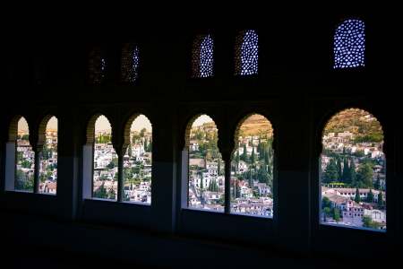 fantastic view: From the Alhambra looking through the arabic windows you have a fantastic view over the city of Granada