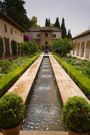 Whilst fountains and flowing water are a common feature around the Alhambra, they are particularly prevalent in the Palacio de Generalife. Stock Photo - 16179621
