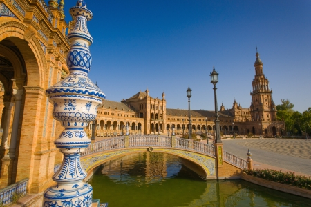 The Plaza de España is a Square  located in the Parque de María Luisa in Seville, Spain  Built in 1928 for the Ibero-American Exposition of 1929  It is a landmark example of the Renaissance Revival style in Spanish architecture  The Plaza de España, de Editorial