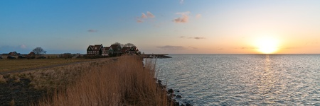 Sunrise @ the island of Marken. This is a Island in the IJsselmeer in Holland. photo