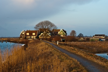 Fishermen's cottages along the Dutch dike at Marken photo