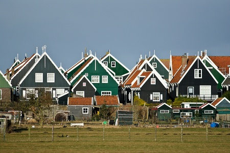 contributed: For over a century, the former fishing village, an important tourist attraction. The striking costumes contributed to this. Characteristic are the wooden houses on stilts. Even older are called yards, artificial increases that was lived. The main street i Stock Photo