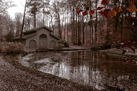 lake dwelling: Historic boathouse in the autumn forest