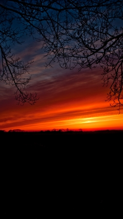 nederland: Bright red sky in the late