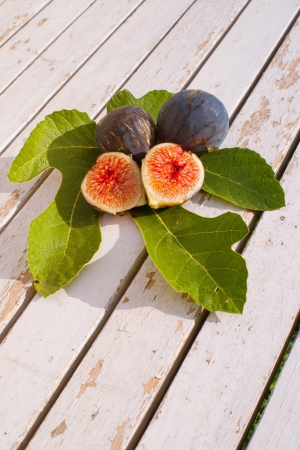 Figs on wooden rustic background photo