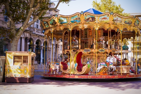 An old fashioned carousel sits in the middle of the square in Avignon, France