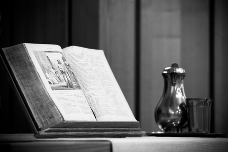 Holy bible in church with chalice photo