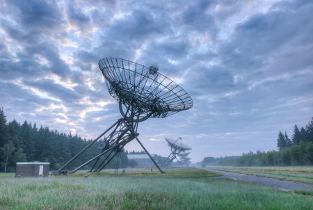 Radio Telescopes at foggy sunset  in Westerbork, the Netherlands Stock Photo - 23030334