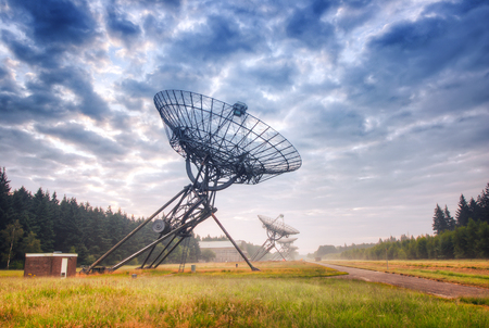 county side: Radio Telescopes at foggy sunset  in Westerbork, the Netherlands