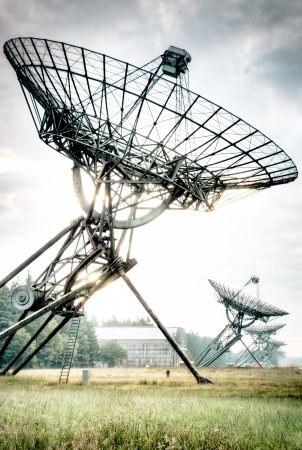 Radio Telescopes at foggy sunset  in Westerbork, the Netherlands Stock Photo - 23030338