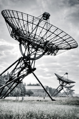 Radio Telescopes at foggy sunset  in Westerbork, the Netherlands photo