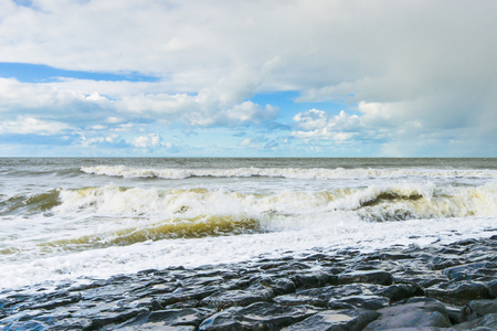 waterworks: Sea ​​waves throw themselves on the rocks of the  waterworks of Netherlands Stock Photo