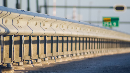 Guard rail or guardrail, sometimes referred to as guide rail or railing, is a system designed to keep people or vehicles from straying into dangerous or off-limits areas  photo
